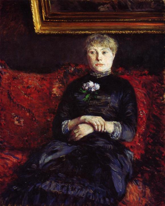 woman-sitting-on-a-red-flowered-sofa.jpg